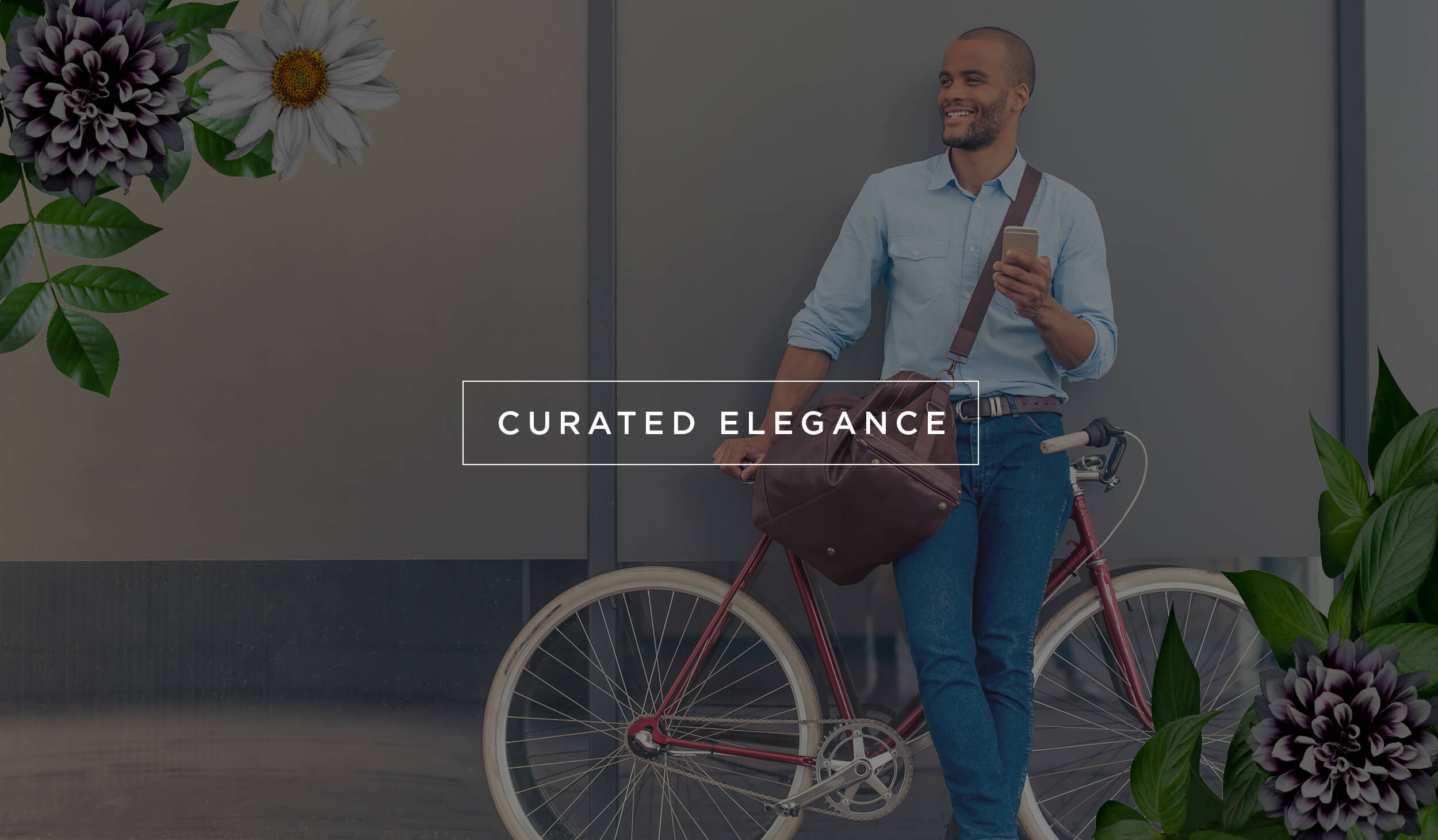 photo of man in business casual clothing, with a bag on his shoulder, holding a cell phone and leaning against a bicycle, the photo have a gray tint overlay with white text that reads, CURATED ELEGANCE in a rectangle outlined in white